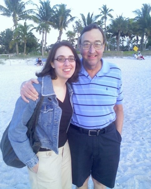 laura white and her father dan on a beach